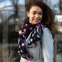 POM Peace Of Mind Reversible Scarf with Jacquard Hearts in Navy and Pastel Multi Colour